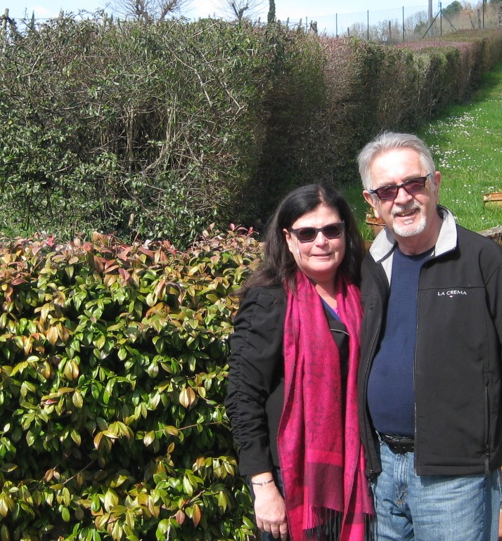 patricia j scot with her husband in a garden wearing glasses